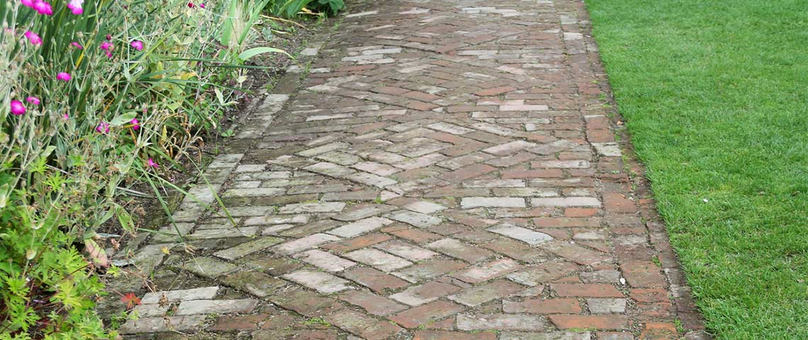 How To Kill And Prevent Sidewalk And Patio Moss. Brick Paving In A Garden